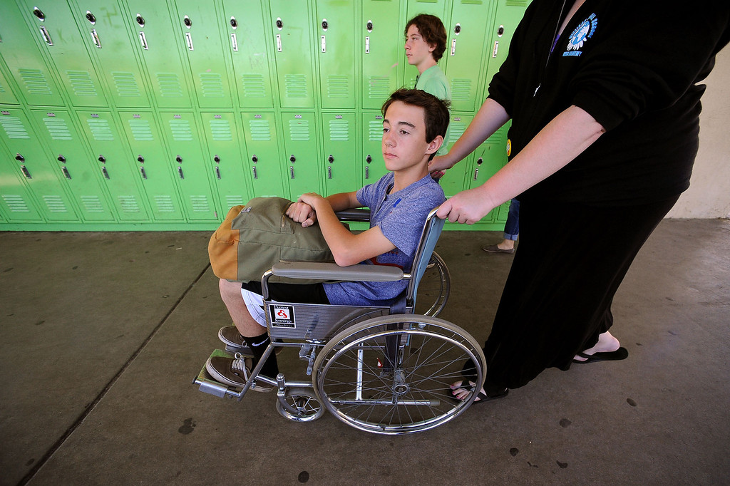 . Ryan Vock plays the role of an injured student at Millikan Middle School while participating in the Great American Shakeout in Sherman Oaks, CA, October 17, 2013.  (Andy Holzman/Los Angeles Daily News)