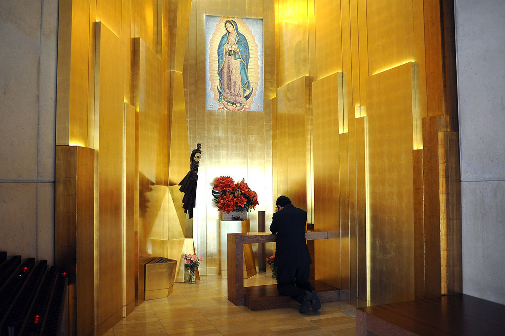 . A man visits the chapel where a piece of Saint Juan Diego\'s famous cloak bearing the image of Our Lady of Guadalupe is displayed at the Cathedral of Our Lady of the Angels in Los Angeles, CA November 20, 2013.(Andy Holzman/Los Angeles Daily News)
