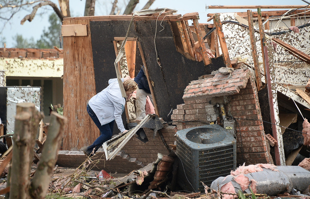 . A woman tries to look for belongings in her home.  