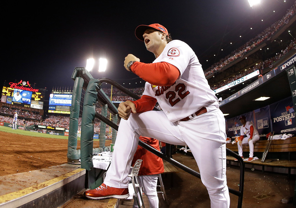 . St. Louis Cardinals manager Mike Matheny yells from the dugout during the second inning of Game 1 of the National League baseball championship series against the Los Angeles Dodgers, Friday, Oct. 11, 2013, in St. Louis. (AP Photo/Jeff Roberson)