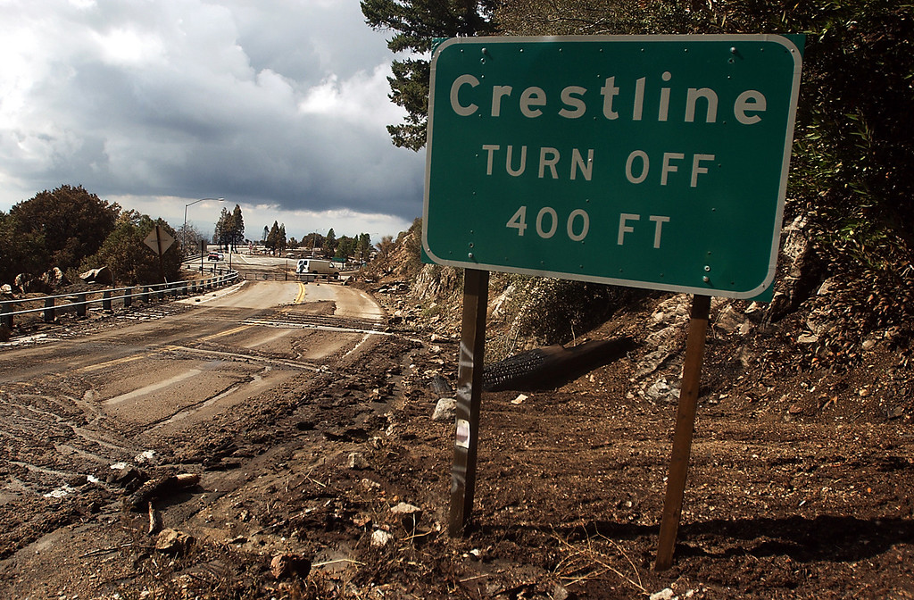 . Ten years ago this month the arson caused Old Fire, fanned by Santa Ana winds burned thousands of acres, destroyed hundreds of homes and caused six deaths. The fire burned homes in San Bernardino, Highland, Cedar Glen, Crestline, Running Springs and Lake Arrowhead and forced the evacuation of thousand of residents. Highway 18  to Lake Arrowhead is blocked from a mudslide as seen looking west near the Crestline turnoff in the San Bernardino National Forest. (Staff file photo/The Sun)