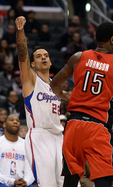 . The Clippers� Matt Barnes #22 sinks a 3-point shot as the Raptors� Amir Johnson #15 defends during their game at the Staples Center in Los Angeles Friday, February 7, 2014. (Photo by Hans Gutknecht/Los Angeles Daily News)