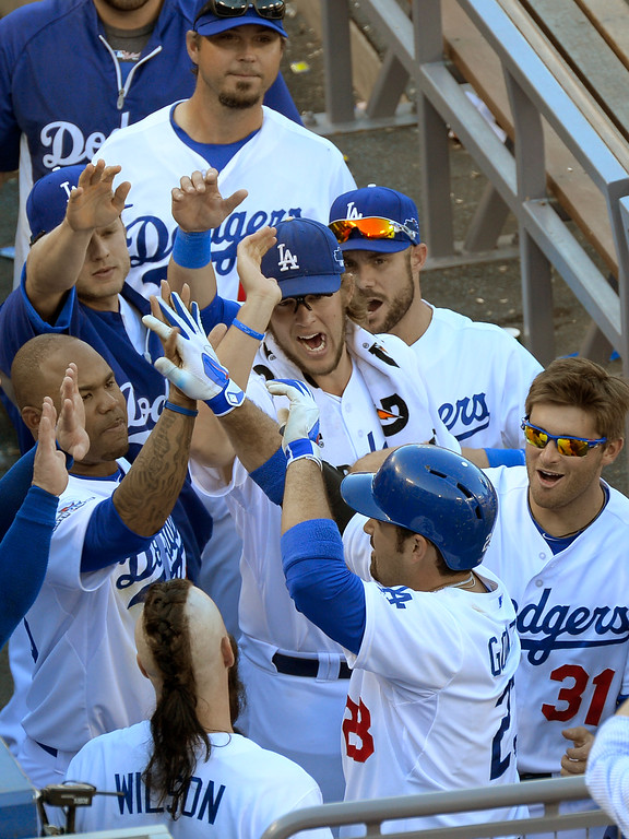 . Andrian#23 Gonzalez is congratulated on his solo homer in the 8th inning. The Dodgers played the Saint Louis Cardinals in game 5 of the National League Championship Series at Dodger Stadium in Los Angeles, CA. 10/15/2013. photo by (John McCoy)/Los Angeles Daily News)