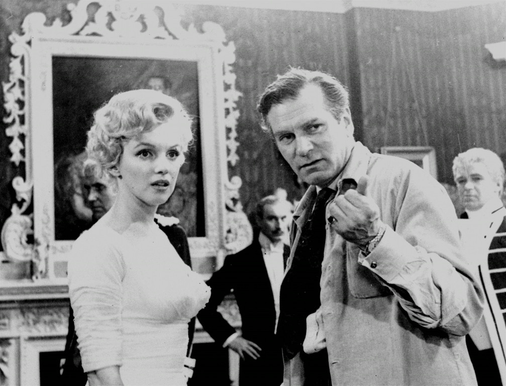 ". Marilyn Monroe learns the English way to make a movie as her director and co-star, Sir Laurence Olivier gives her advice in London on Aug. 14, 1956.  In ""The Prince and the Showgirl\"",  Miss Monroe plays the part of an American show girl starring in a London musical in 1911. (AP Photo)"