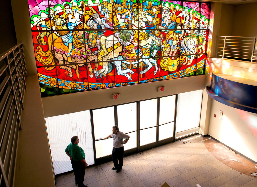 ". PIH Health has purchased the former Montebello, Calif. Home Savings and Loan to use as an urgent care facility.  Two historic items, a stained glass window, �The Carousel�, pictured, designed by Susan Hertel and fabricated by John Wallis and Associates on the south façade, and a mosaic mural, ""A Day in the Country\"", designed by Millard Sheets and executed by Nancy Colbath on the building�s north façade will be preserved by PIH at the Beverly Boulevard location Jan. 21, 2014. (Staff photo by Leo Jarzomb/Whittier Daily News)"