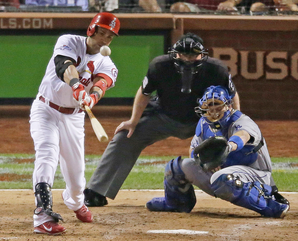 . St. Louis Cardinals\' Carlos Beltran hits a two-run scoring double during the third inning of Game 1 of the National League baseball championship series against the Los Angeles Dodgers, Friday, Oct. 11, 2013, in St. Louis. (AP Photo/Chris Carlson)