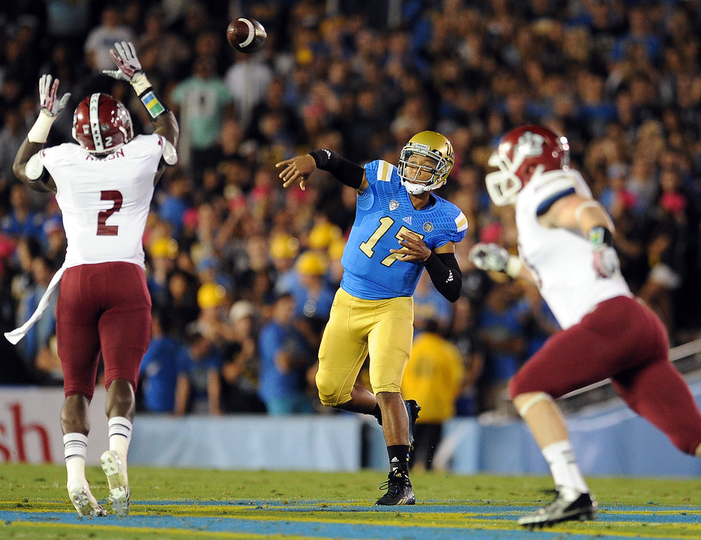 . UCLA quarterback Brett Hundley (17) passes against New Mexico State during the first half of their college football game in the Rose Bowl in Pasadena, Calif., on Saturday, Sept. 21, 2013.   (Keith Birmingham Pasadena Star-News)