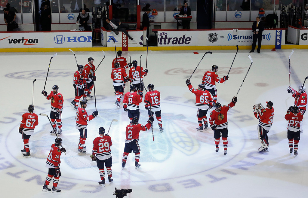 . The Chicago Blackhawks celebrate after beating the Los Angeles Kings 4-2 in Game 2 of the NHL hockey Stanley Cup Western Conference finals Sunday, June 2, 2013 in Chicago. (AP Photo/Charles Rex Arbogast)