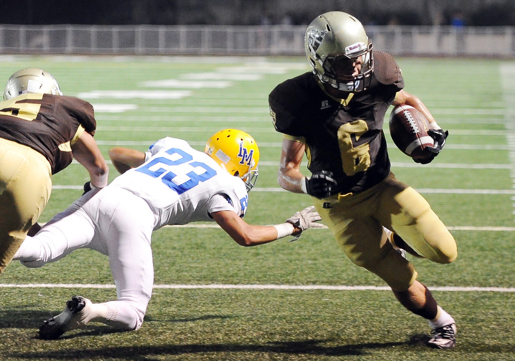 . St. Francis\' Joe Mudie (C) (6) runs for a touchdown past La Mirada\'s Austin Falcetti (23) in the first half of a prep football game at St. Francis High School in La Canada, Calif. on Thursday, Sept. 19, 2013.    (Photo by Keith Birmingham/Pasadena Star-News)
