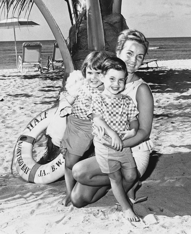 . Actress Debbie Reynolds spends a 2-week vacation at the Half Moon Hotel in Montego Bay, Jamaica, Jan. 26, 1961 accompanied by her children, Carrie and Todd. (AP Photo)