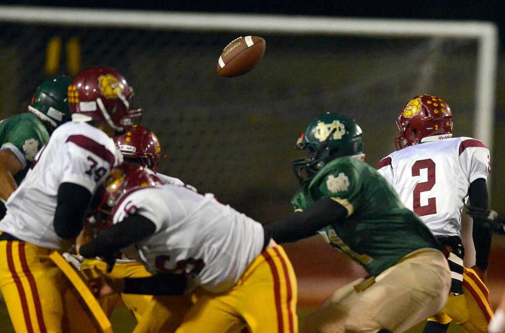 . Highland QB Donte Ross tries to recover a fumbled ball in first-half quarter action in the CIF Southern Section Northern Division first-round football game between the Highland High School Bulldogs and Mira Costal Mustangs at Costa Friday evening, 11/15/2013.  Photo for The Daily Breeze by Axel Koester, 11/15/2013.