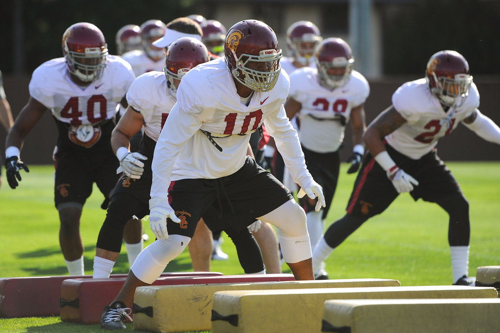 . USC linebacker Hayes Pullard leads the defense through footwork drills at practice, Thursday, March 27, 2014, at USC. (Photo by Michael Owen Baker/L.A. Daily News)