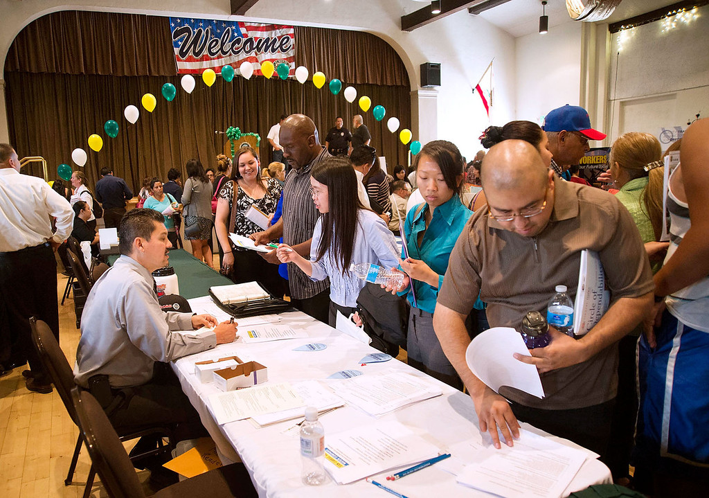 . Job seekers attend the El Monte Job Fair, one of the largest job fairs in the San Gabriel Valley, at the El Monte Community Center on Friday, June 21, 2013. Over the last 12 months California\'s economy added 252,100 jobs, a growth rate of 1.8 percent. (SGVN/Staff photo by Watchara Phomicinda)