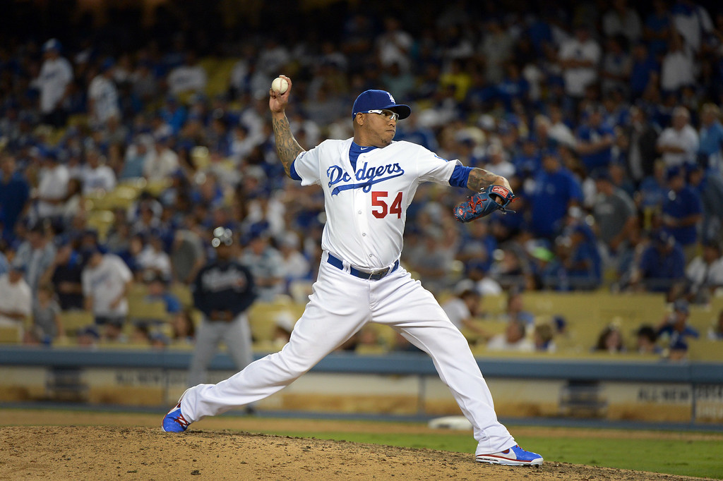 . Los Angeles Dodger\'s Ronald Belisario pitches during game 3 of the NLDS at Dodger Stadium Sunday, October 6, 2013. (Photo by David Crane/Los Angeles Daily News)