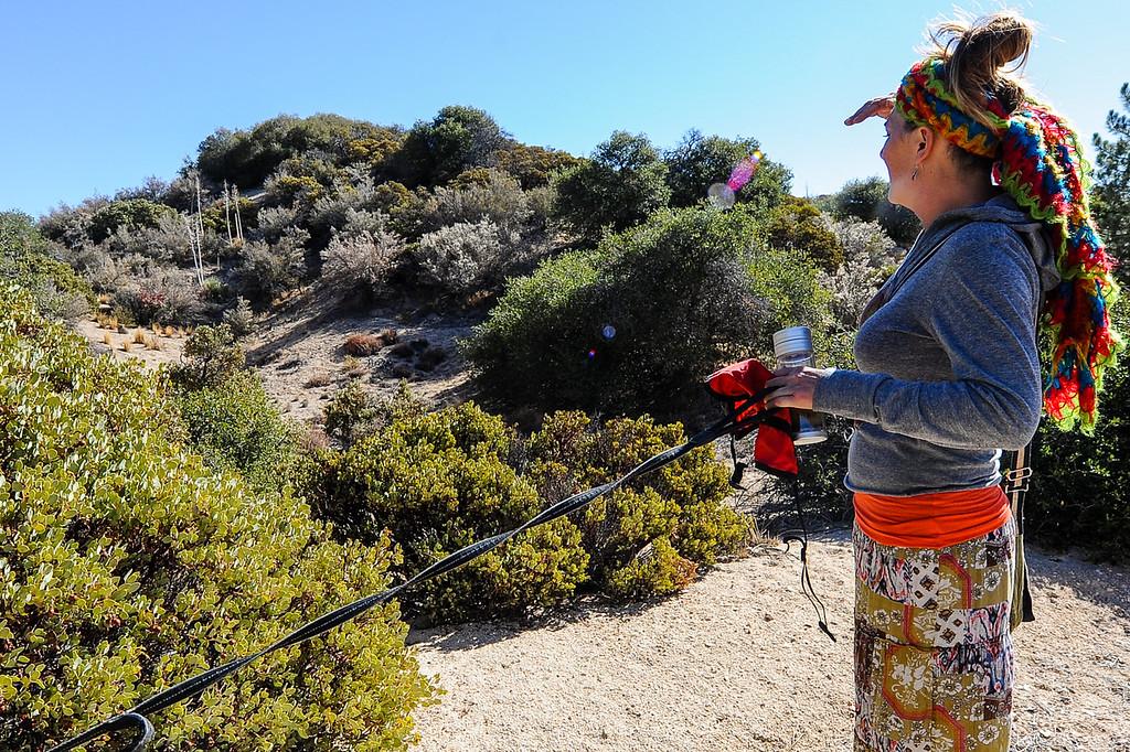 . Search and rescue volunteer Lynne Lomerick, of Deer Lodge Park, searches along the Pinnacle Trail for a missing German hiker in the San Bernardino Mountains near Lake Arrowhead on Friday, Oct. 4, 2013. (Photo by Rachel Luna / San Bernardino Sun)