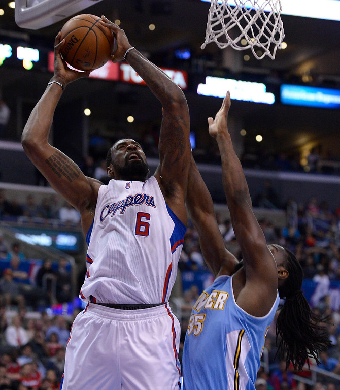 . Clippers#6 DeAndre Jordan goes up for a shot against Nuggets #35 Kenneth Faried in the first half. The Los Angeles Clippers took on the Denver Nuggets in a regular season NBA game. Los Angeles, CA. 4/15/2014(Photo by John McCoy / Los Angeles Daily News)