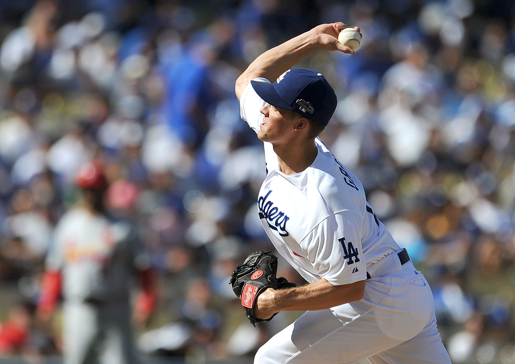 . The Dodgers\' starting pitcher Zack Greinke delivers a pitch against the Cardinals during game 5 of the NLCS at Dodger Stadium Wednesday, October 16, 2013.Hans Gutknecht/Los Angeles Daily News)
