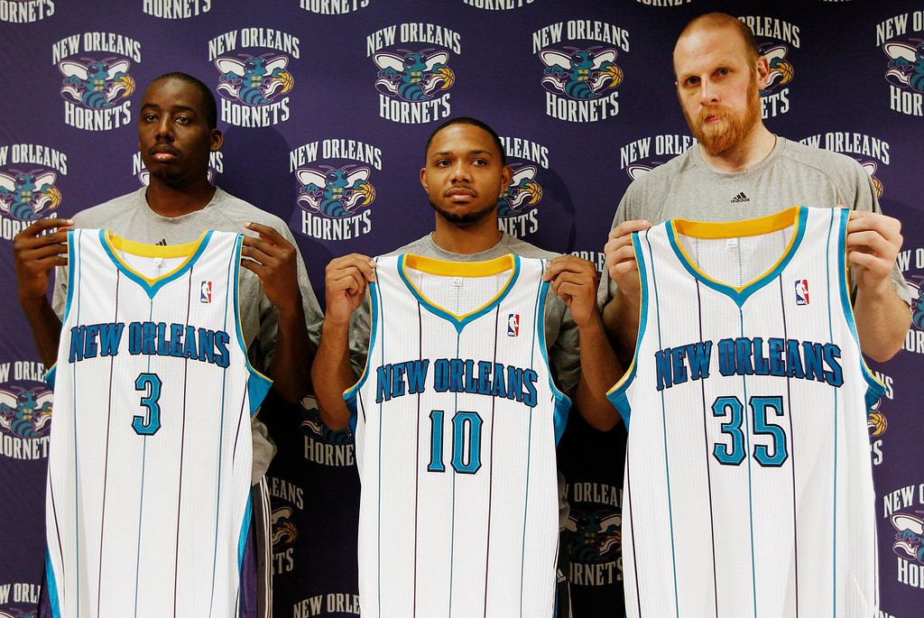 . New Orleans Hornets new players, from left, forward Al-Farouq Aminu, guard Eric Gordon, and center Chris Kaman pose for photos during an NBA basketball news conference in New Orleans on Saturday, Dec. 17, 2011. (AP Photo/Jonathan Bachman)