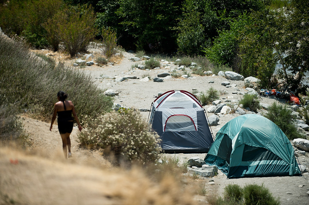. People enjoy a hot day in San Gabriel River in the East Folk area of Angeles National Forest above Azusa on Wednesday, July 3, 2013. (Photo by Watchara Phomicinda)