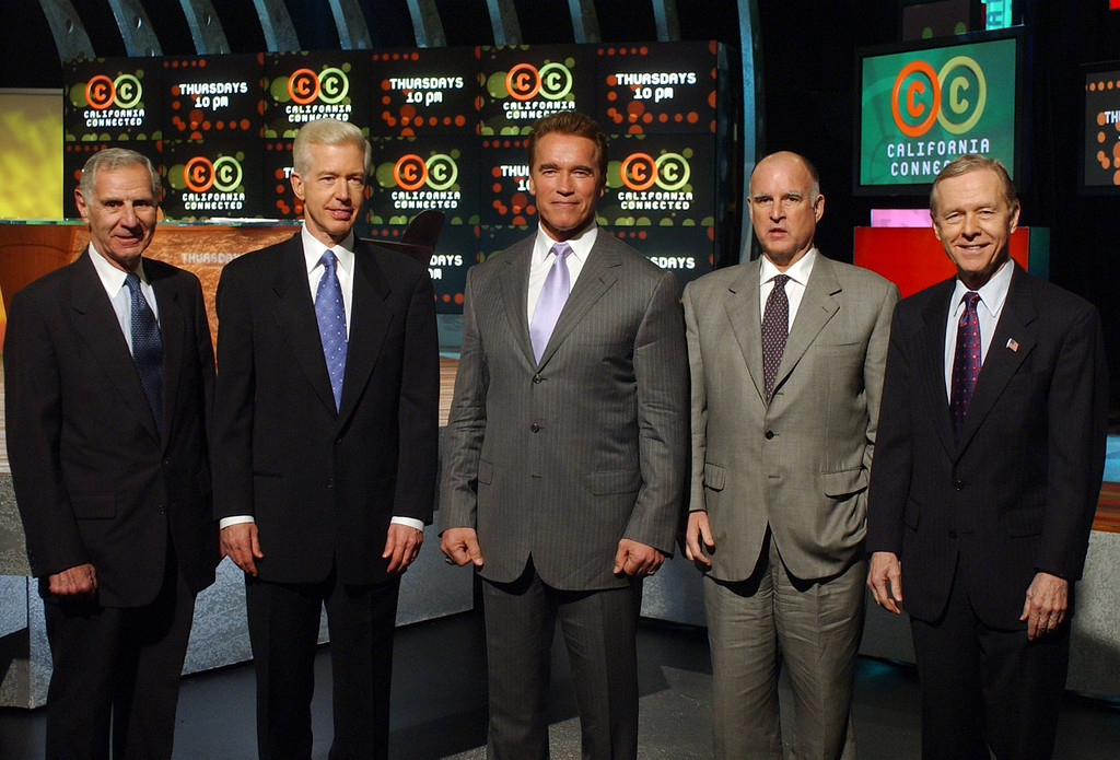 """. Former California Governors George Deukmejian, far left, Gray Davis, second from left, Jerry Brown, second from right, and Pete Wilson, far right, join current Governor Arnold Schwarzenegger, center, in a group photo prior to taping a forum on \""""California Connected,\"""" Tuesday, Feb. 17, 2004, in Los Angeles.  The show featured a panel discussion on \""""Can California Be Governed\"""" with the four former governors and a one-on-one interview with the new governor. (AP Photo/Rene Macura)"""