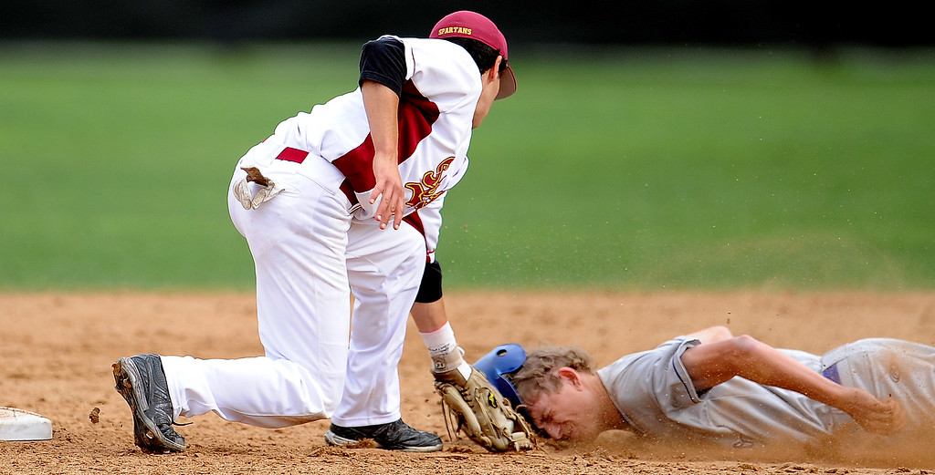 . San Marino\'s Willie Forgatch is tagged out by La Canada shortstop Clayton Herrmann (C) at second base on a attempted steal in the fifth inning of a prep baseball game at La Canada High School on Wednesday, March 8, 2013 in La Canada, Calif. La Canada won 3-2.  (Keith Birmingham Pasadena Star-News)