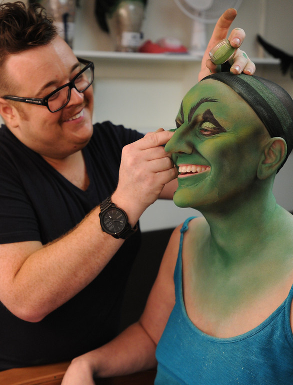 . Highlights are added. Jacquelyn Piro Donovan is transformed into the Wicked Witch by makeup artist Michael King. The Wizard of Oz is being staged at the Pantages Theatre in Hollywood, CA. 9/25/2013. photo by (John McCoy/Los Angeles Daily News)