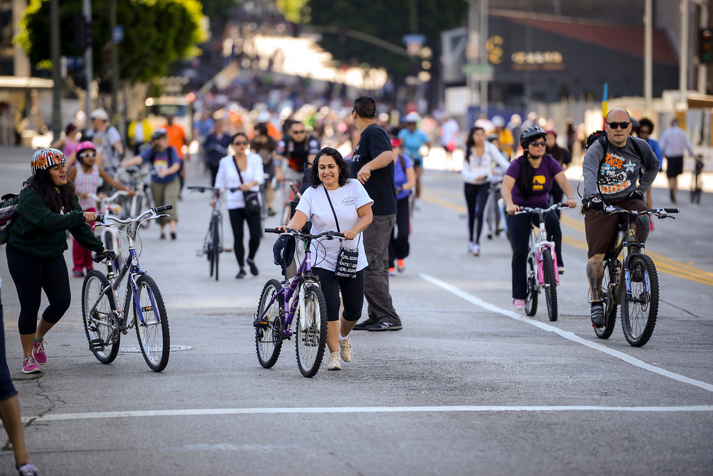 . Bike riders pedal along Wilshire blvd. at Ciclavia Sunday April 6, 2014.  Wilshire blvd was closed between Grand Avenue and Fairfax Avenue from 9 a.m. to 4 p.m for busses only.  ( Photo by David Crane/Los Angeles Daily News )
