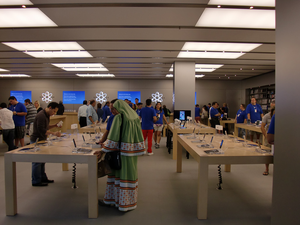 . Blue-shirted Apple Store employees might not have outnumbered actual customers in the Westfield Topanga location, but it was close. (Photo by Steven Rosenberg/Los Angeles Daily News)