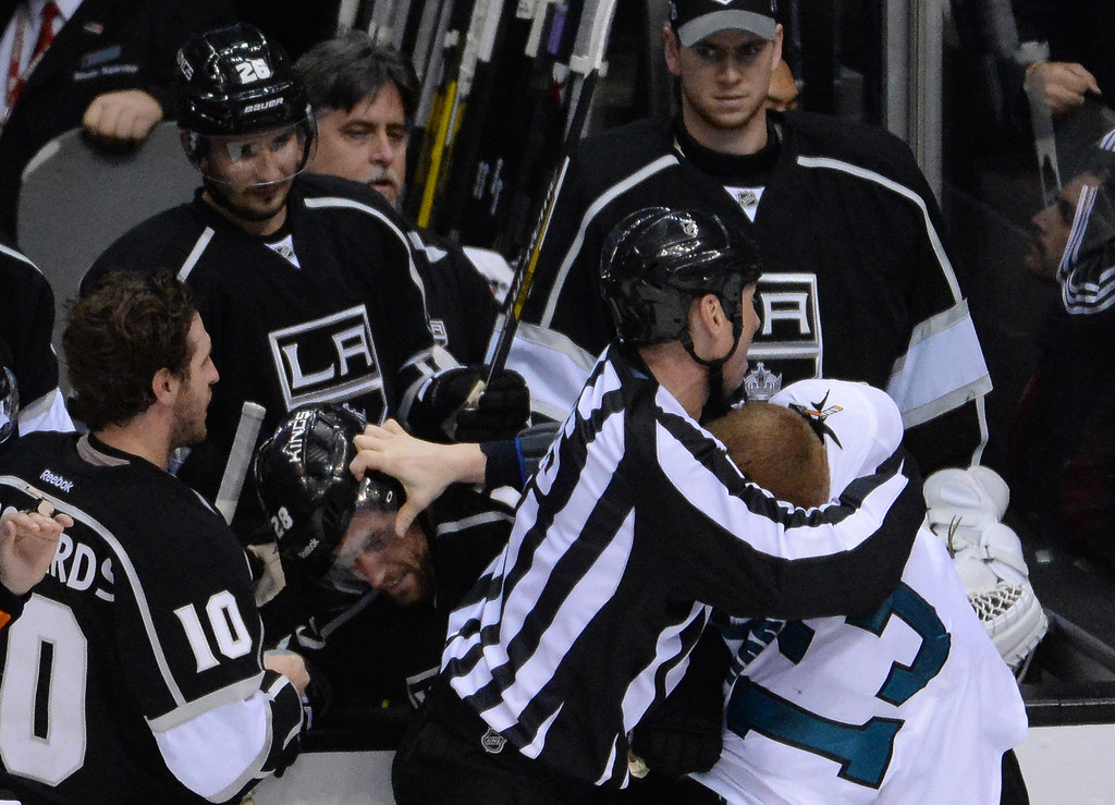 . San Jose Sharks left wing Raffi Torres (13) fights Los Angeles Kings center Jarret Stoll (28) as the officials tray to break it up during the third period in Game 4 of an NHL hockey first-round playoff series at Staples Center in Los Angeles on Thursday, April, 24  2014. Los Angeles Kings won 6-3. (Keith Birmingham Pasadena Star-News)
