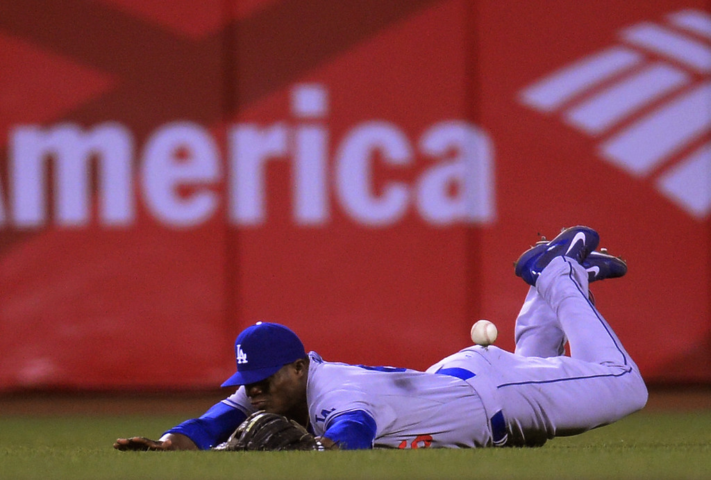 . SAN FRANCISCO, CA - SEPTEMBER 25:  Yasiel Puig #66 of the Los Angeles Dodgers dives but can\'t make the catch of this ball that goes for an rbi double off the bat of Tony Abreu #10 of the San Francisco Giants (not pictured) during the six inning at AT&T Park on September 25, 2013 in San Francisco, California.  Giants won 6-4.  (Photo by Thearon W. Henderson/Getty Images)