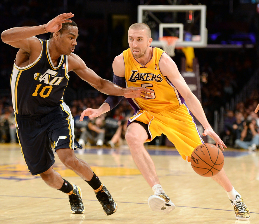 . Lakers\' Steve Blake (5) moves the ball down court against the Jazz\'s Alec Burks (10) in a NBA Western Conference basketball game at the Staples Center Tuesday, February 11, 2014, Los Angeles, CA.  The Lakers lost 79-96.
