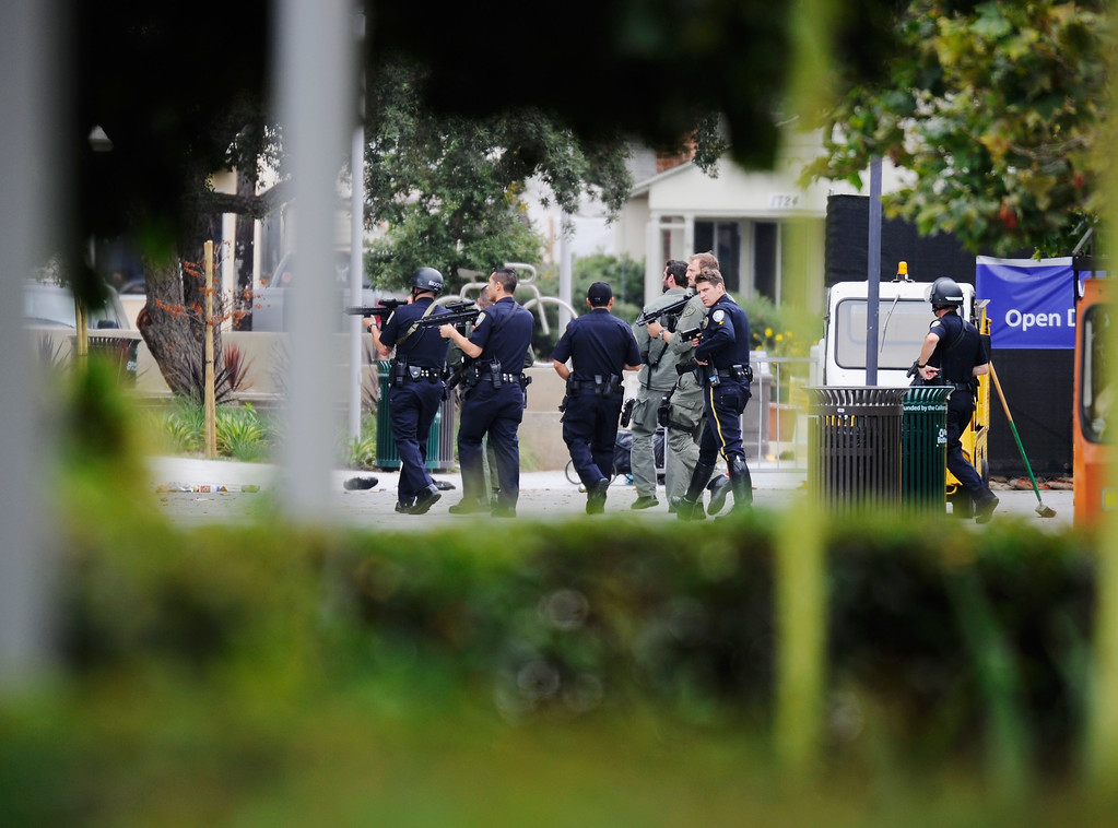 . SANTA MONICA, CA - JUNE 07:  Los Angeles Police Department officers along with Los Angeles County Sheriff deputies search the grounds of Santa Monica College near the library after multiple shootings were reported on the campus June 7, 2013 in Santa Monica, California.  According to reports, at least three people have been injured, and a suspect was taken into custody. (Photo by Kevork Djansezian/Getty Images)