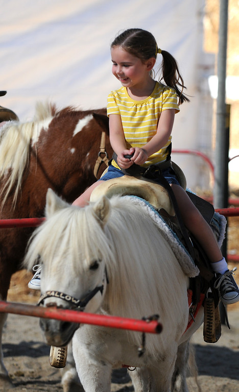 . Brooke Bird-Cespedes, 4, from Westlake Village enjoys the pony ride.  Underwood Family Farms in Moorpark, CA hosted its Friends of the Farm weekend, launching its Fall Harvest Festival, which runs through Halloween.  The Saturday, September 28, 2013, event benefits the Ventura County Sheriff\'s & Fire Departments.  (Photo by Dean Musgrove/Los Angeles Daily News)