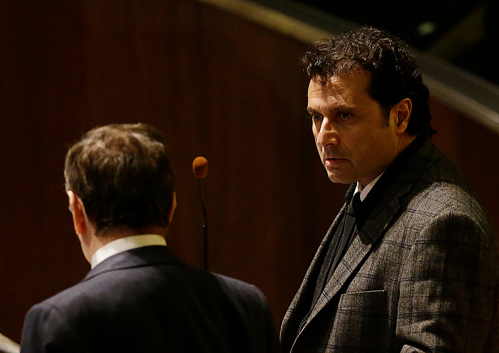 . Francesco Schettino, right, attends his trial in Grosseto, Italy, Wednesday, Feb. 11, 2015. The captain of the capsized Costa Concordia luxury liner has been convicted of multiple charges of manslaughter and sentenced to 16 years in jail. Francesco Schettino wasn\'t present when Judge Giovanni Puliatti read out the verdict Wednesday night in a Grosseto theater. The verdict and sentencing brought a close to a trial that has been running since July 2013. (AP Photo/Gregorio Borgia)
