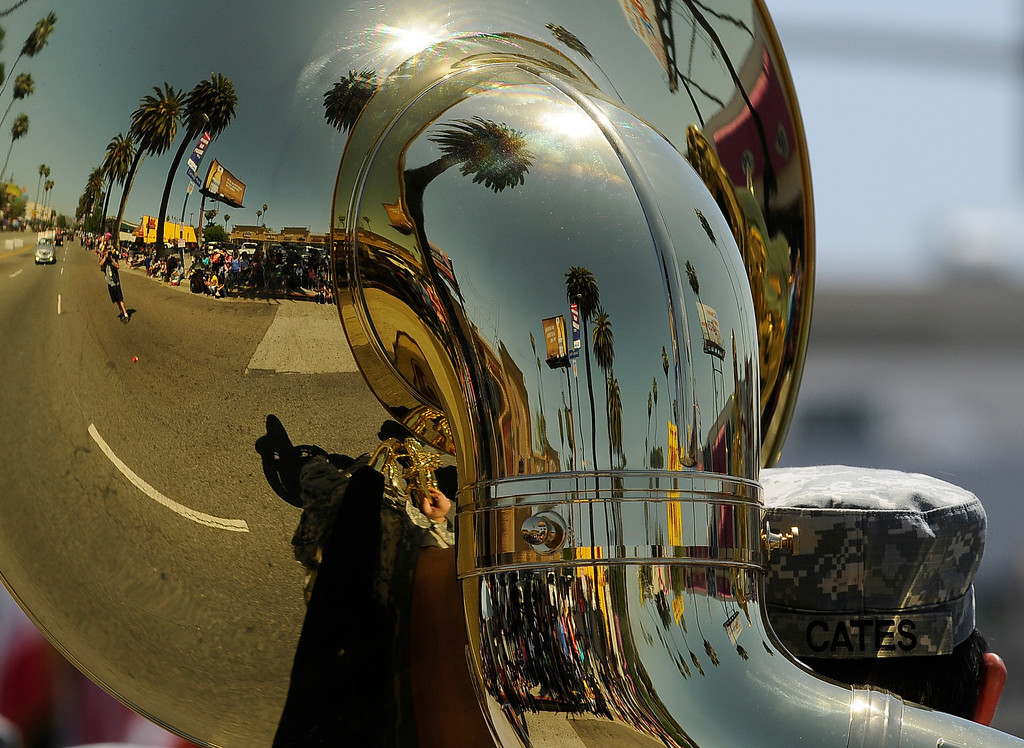 . Palm trees and parade goers are reflected in the bell on a tuba played by a member of the 40th Infantry Divisionn Band from the California Army National Guard. The Annual Canoga Park Memorial Day Parade marched down Sherman Way from Owensmouth east to Mason Street where it concluded at the First Baptist Church. Canoga park, CA 5/27/2013(John McCoy/LA Daily News)