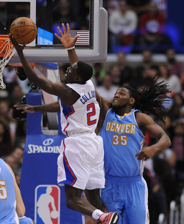. Clippers#2 Darren Collison gets past Denver#35 Kenneth Faried in the second half. The Los Angeles Clippers defeated Denver Nuggets 117 to 105 in a regular season NBA game. Los Angeles, CA. 4/15/2014(Photo by John McCoy / Los Angeles Daily News)