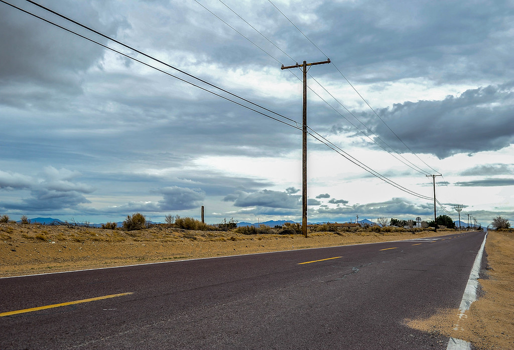 . Clouds loom over the rural roads and desert in Hinkley, Calif. on Thursday, March 7, 2013. In the last two years, residents have become aware that a toxic water plume continues to grow below their small town. (Rachel Luna / San Bernardino Sun)