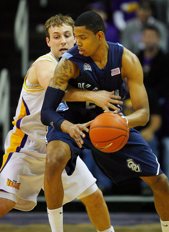 . Northern Iowa\'s Ali Farokhmanesh, left, defends Old Dominion\'s Kent Bazemore, right, during the first half of an NCAA college basketball game Friday, Feb. 19, 2010, in Cedar Falls, Iowa. Farokhmanesh led the team with 23 points and Northern Iowa won 71-62. (AP Photo / Matthew Putney)