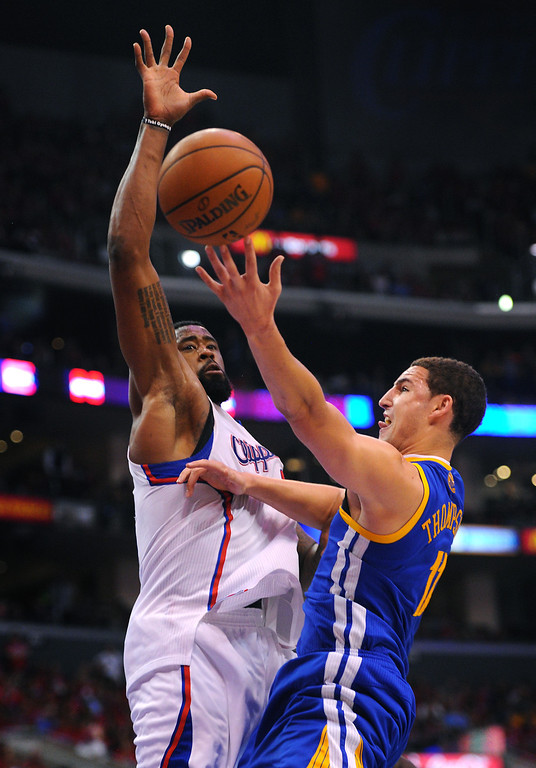 . The Clippers\' DeAndre Jordan defends the basket against the Warriors Klay Thompson in game seven of the Western Conference playoffs, Saturday, May 3, 2014, at Staples Center. (Photo by Michael Owen Baker/L.A. Daily News)