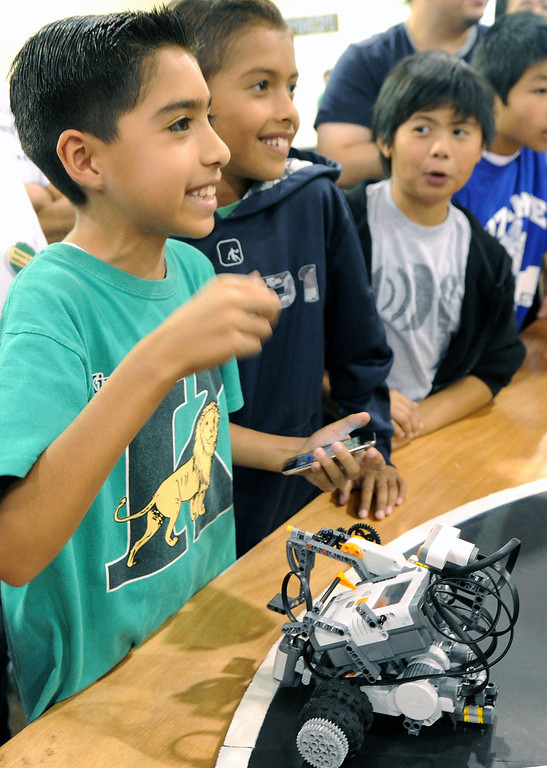 """. Daniel Baca, 4th grade student from Kingsley Elementary of Pomona with his team winning robot of competition, named \""""Sleedy McMean\"""". Cal Poly Pomona\'s Robotics Initiative invited 200 elementary and middle school students to a Robot Expo at LA Fairplex in Pomona Monday, May 20, 2013. (SGVN/Photo by Walt Mancini)"""