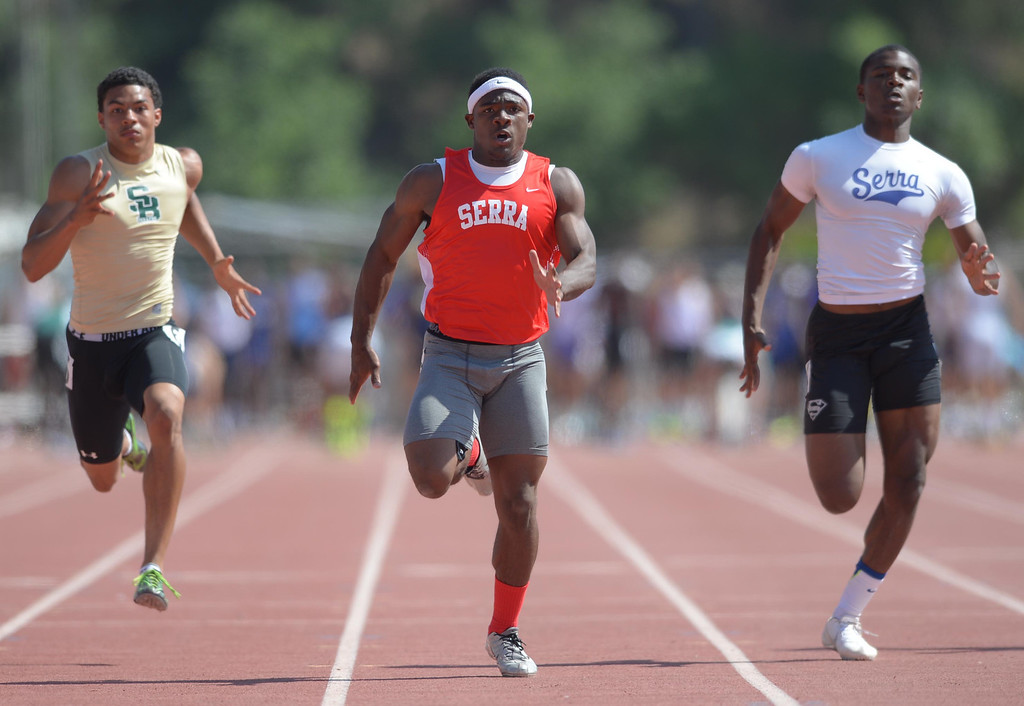 . Serra\'s Malik Roberson, center, powers to a win in the 100 meter Division 4 race of the CIF Southern Section Track and Field Championships Saturday at Mt. SAC. Teammate Darrell Fuery, right, took second. 20130518 Photo by Steve McCrank / Staff Photographer