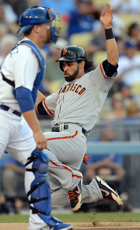 . The Giants\' Angel Pagan #16 scores in the first inning as Dodger catcher Tim Federowicz #18 waits for the throw during their game at Dodgers Stadium Saturday, September 14, 2013. (Photo by Hans Gutknecht/Los Angeles Daily News)