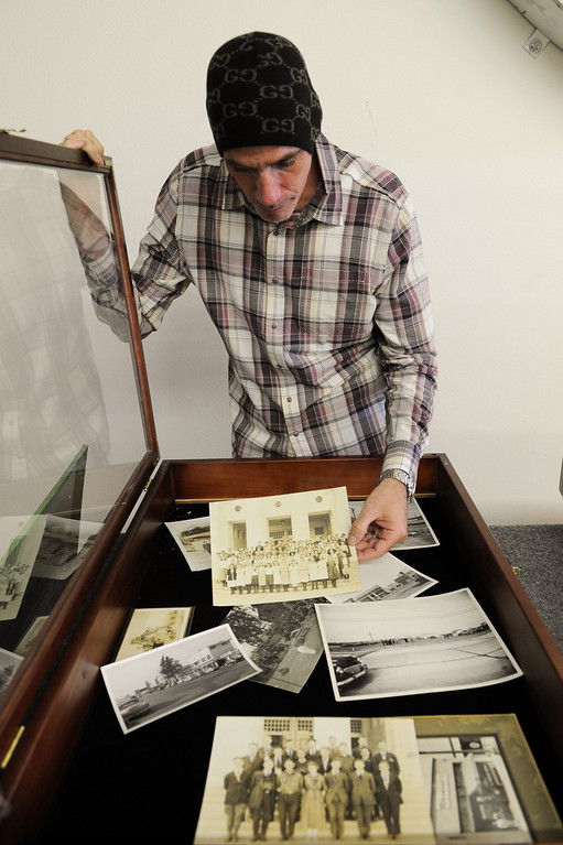 . Tommy Gelinas, owner of Valley Relics Museum in Chatsworth, looks through a case of old pictures at his museum. (Photo by Michael Owen Baker/L.A. Daily News)