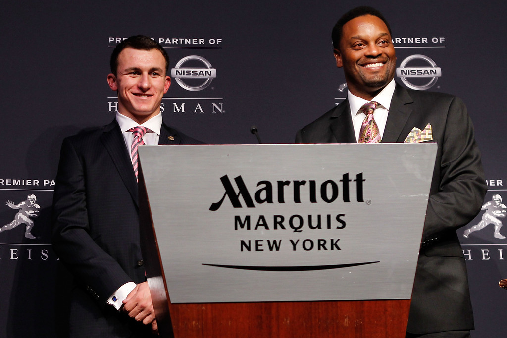 . (L-R) Quarterback Johnny Manziel of the Texas A&M University Aggies and head coach Kevin Sumlin pose after being named the 78th Heisman Memorial Trophy Award winner at a press conference at the Marriott Marquis on December 8, 2012 in New York City.  (Photo by Mike Stobe/Getty Images)