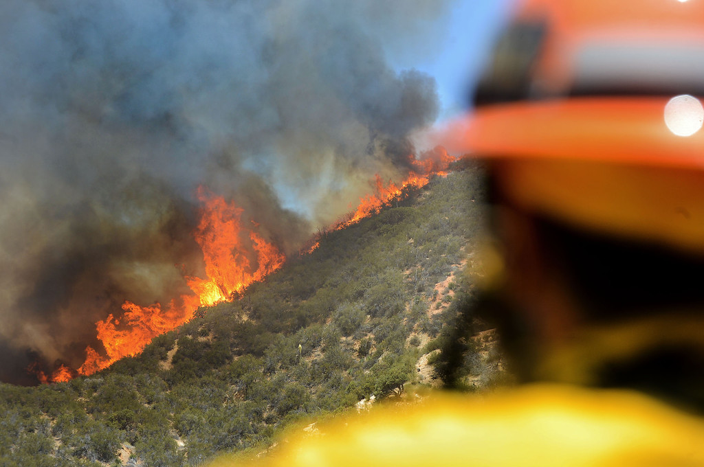 . A firefighter keeps watch on the Powerhouse Fire near Green Valley, CA Friday, May 31, 2013.(Andy Holzman/Staff Photographer)