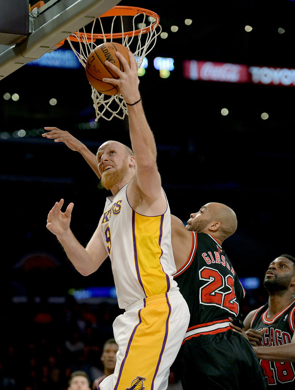 . Los Angeles Lakers\' Chris Kaman get a basket over Chicago Bulls\' Taj Gibson in the NBA basketball game at Staples Center in Los Angeles, CA. on Sunday, February 9, 2014. (Photo by Sean Hiller/ Daily Breeze).