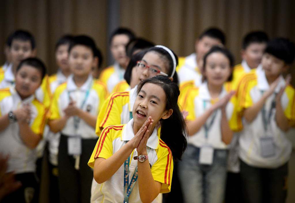 . Yu Tong Liu, 10, a fourth grader from Harbin Normal University in China, leads her class in the Happy Clapping Song as the Chinese school children visit Immaculate Conception Catholic School in Monrovia Wednesday, January 22, 2014. (Photo by Sarah Reingewirtz/Pasadena Star-News)