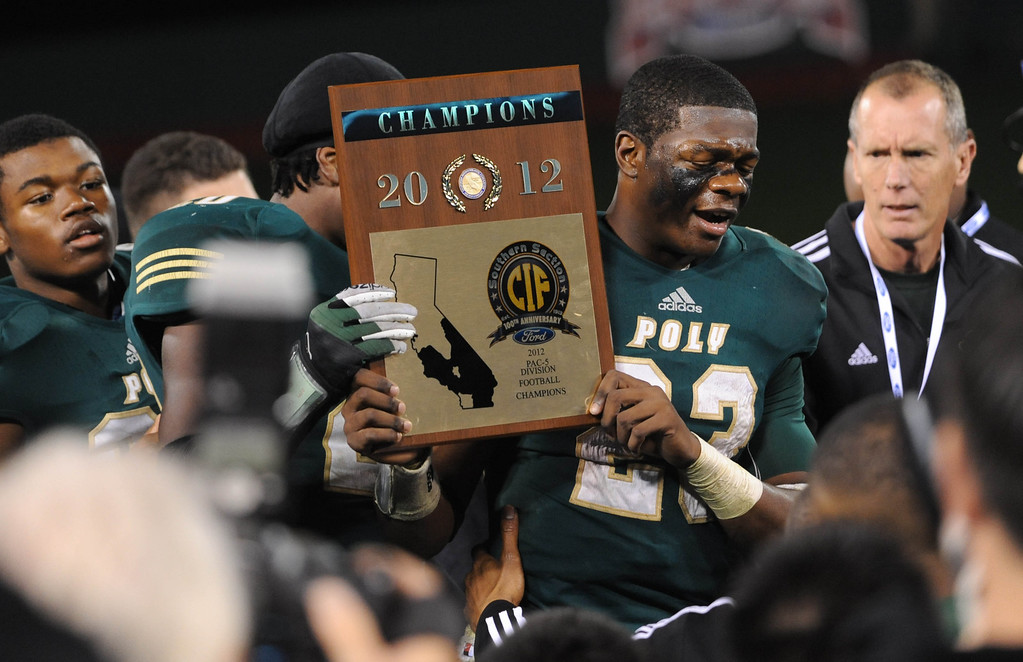 . Anaheim, Calif., --12-01-12 - Long Beach Poly\'s Gerard Wicks,23, celebrates  after he and his team defeated Mater Dei  for the CIF-SS Pac-5 Division championship, at Anaheim Stadium.   Stephen Carr/  LANG