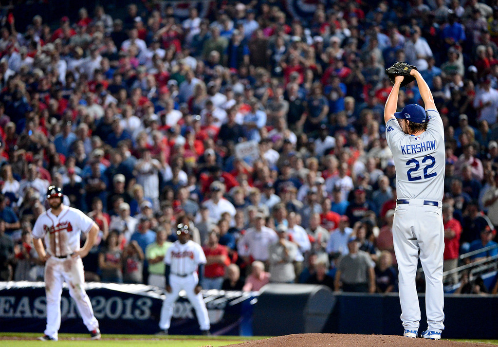 . The Los Angeles Dodgers\' Clayton Kershaw pitches to the Atlanta Braves as they defeat them 6-1 in the first game of the playoffs Thursday, October 3, 2013 at Turner Field in Atlanta, Georgia. (Photo by Sarah Reingewirtz/Pasadena Star- News)