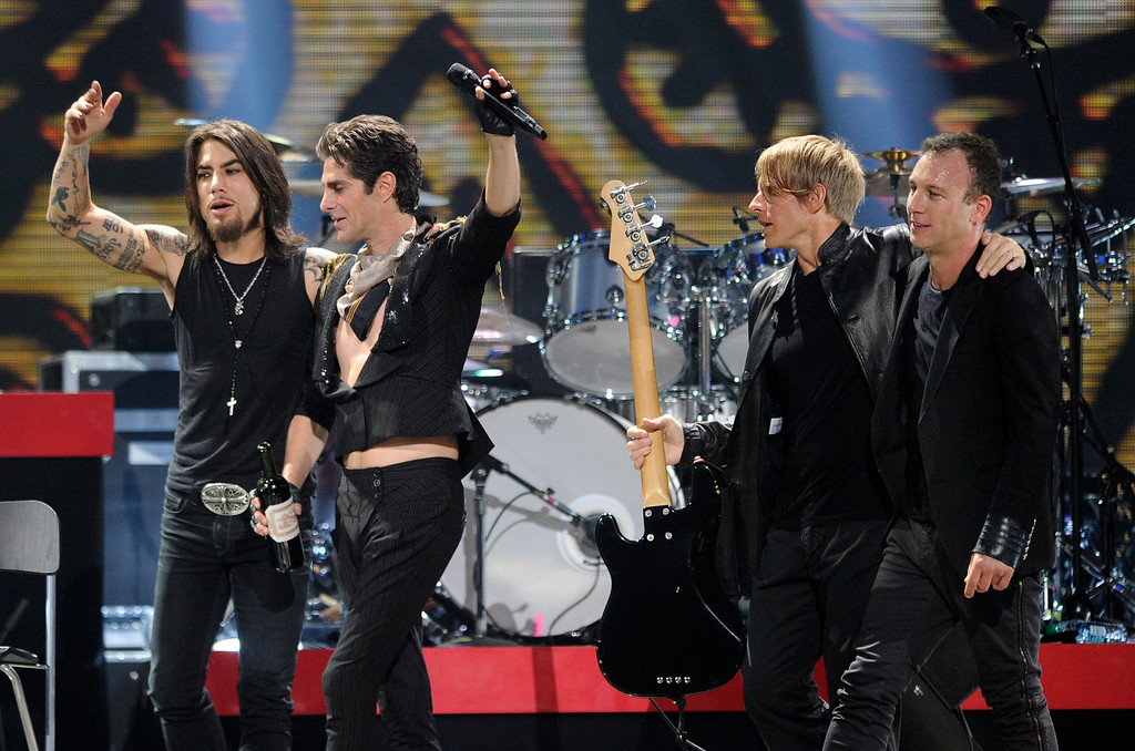 . LAS VEGAS, NV - SEPTEMBER 23:  (L-R) Jane\'s Addiction guitarist Dave Navarro, singer Perry Farrell, bassist Chris Chaney and drummer Stephen Perkins walk of the stage after performing at the iHeartRadio Music Festival at the MGM Grand Garden Arena September 23, 2011 in Las Vegas, Nevada.  (Photo by Ethan Miller/Getty Images for Clear Channel)
